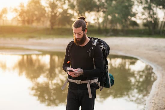 Hiker using cellphone during trip